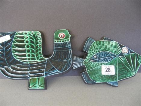 Two Robert Jefferson wall plaques designed as a Fish and a