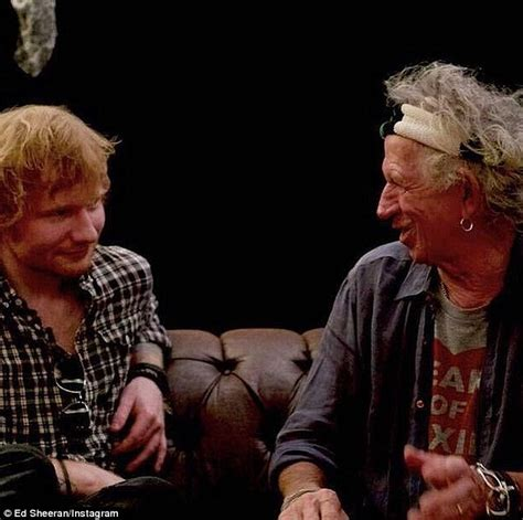 Ed Sheeran poses for a selfie with The Rolling Stones in
